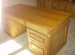 One image of a normal looking oak writing desk.