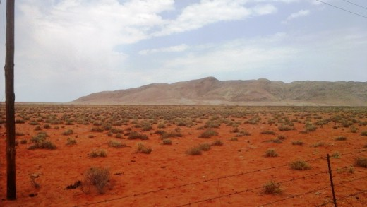 The red sandy soil of the Kalahari  © Martie Coetser