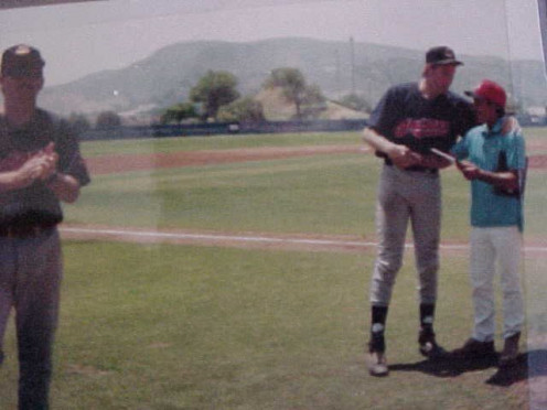 "Here's J. R. Caviness, my manager, presenting the MVP Award of the National Adult Baseball Association Ventura County All-Star game in '96. I was winning pitcher. You could see my 6' 6"" height as opposed to J. R. at 5' 6"""