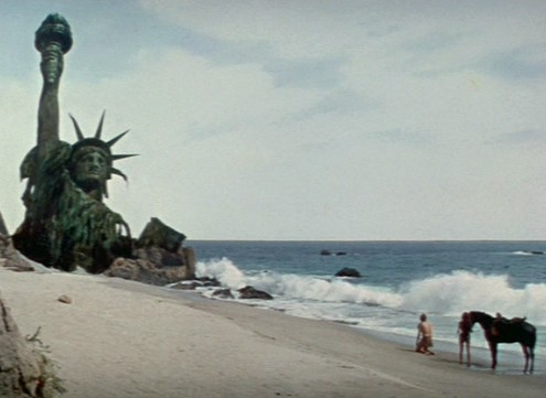 The classic image from the closing scene.  Many other movies have since used the image of a destroyed Statue of Liberty.