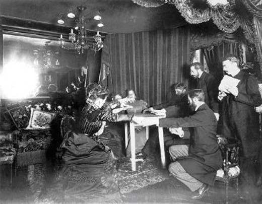 Table levitates during a spiritualist's séance, 1898.