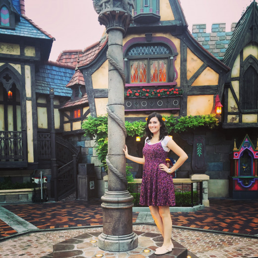 Here I am next to Rapunzels tower inside of the Fantasy Faire section in Disneyland.