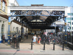 Brighton railway station The David Mocatta designed main station building of 1840 is to the left but this stand-alone iron and glass porte-cochere was added in 1883
