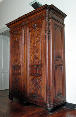 The wardrobe in our old council flat was much darker and less ornate than the one in the image. However, the size and shape are identical.