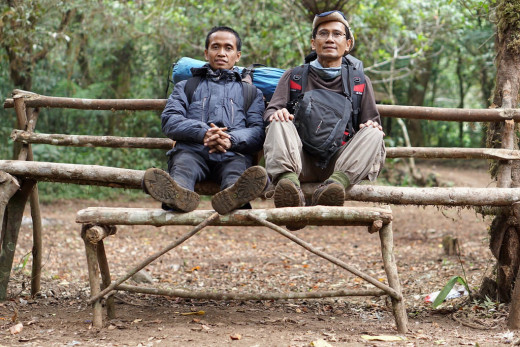 Taking a break at Cigowong on our way down. On the left is Wahyudi, my climbing partner.