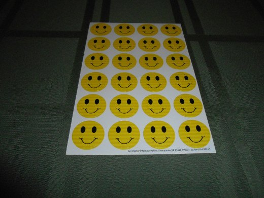The smiley face stickers. One will be included with each note card.