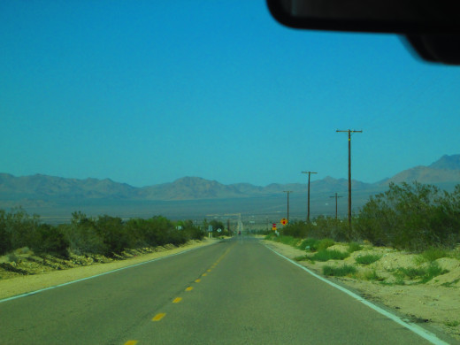 The long stretch of desert highway before turning right on to California State Highway 247.