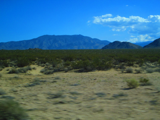 The mountains in the distance are clear, but the sand in the foreground is a bit blurry as we zoom by.