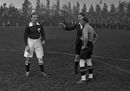 "On the left, Denmark's Poul ""Tist' Nlesen stands in the field. Nelsen remained joint top goalscorer with Jon Dahl Tomasson in Denmark's history"