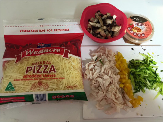 My choice of toppings: pizza cheese, shaved chicken breast, yellow capsicum, mushrooms, shredded zucchini.