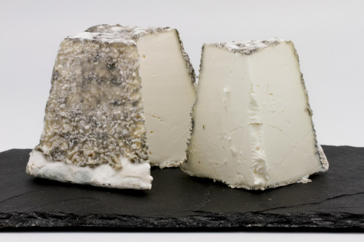 Valencay Cheese famous for  its truncated pyramidal shape.   The Valencay is made by allowing the curd to drain in a mold, it is then removed and covered with salted charcoal ash and allowed to ripen for about 4 to 5 weeks in a well ventilated cellar