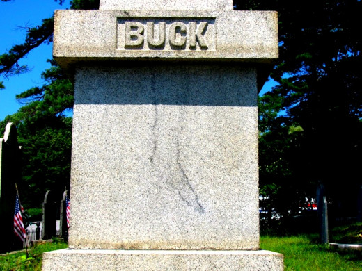 Image of what looks like a foot stained on Jonathan Buck's tombstone.  The stone has been replaced several times, but the stain returns each time.
