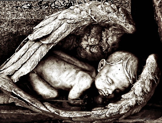Baby cradled in angel's wings