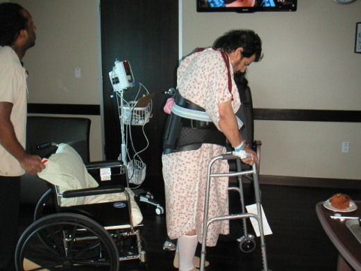 At the hospital after surgery, learning to walk again.
