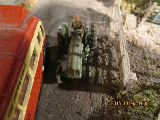 Not far away, on the bridge across the railway, a tractor driver makes his way home - most likely with traffic building up behind! (figure manipulated to fit onto tractor seat)