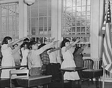 Students pledging allegiance to the American flag with the Bellamy salute