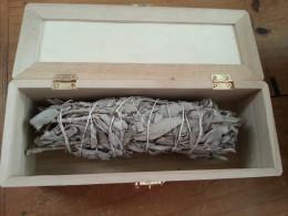 Sage smudge stick in a box.