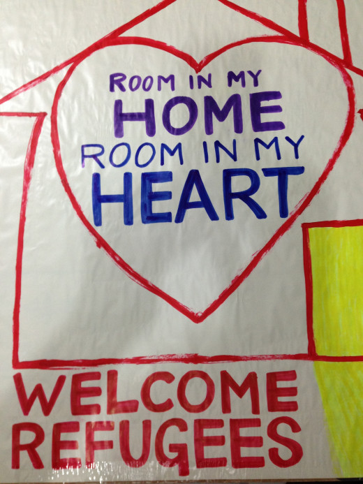 'Room in my home, room in my heart'. Placard used at the 'Welcome Refugees' rally in Brisbane on 31 October 2015