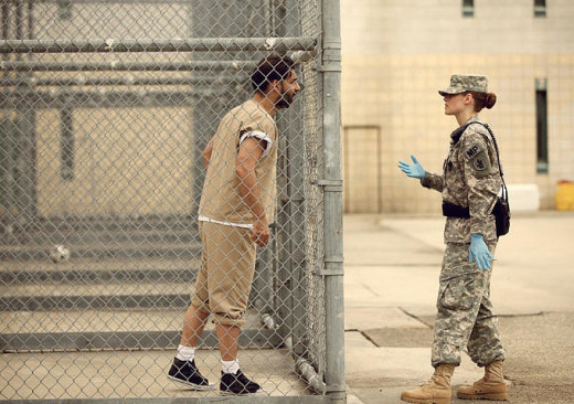A judge's order forbidding female guards from touching prisoners at Guantanamo is criticized in Congress.