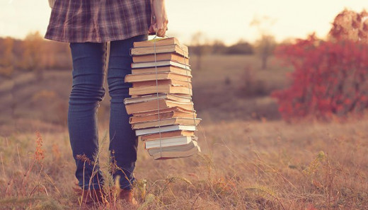 Carry them however you wish, but remember that reading books is essential for any writer.