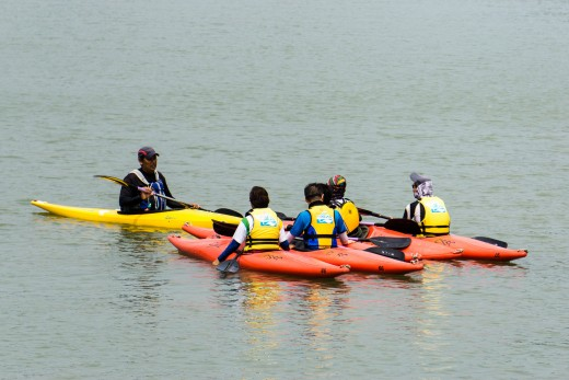A group learning the basics of kayaking