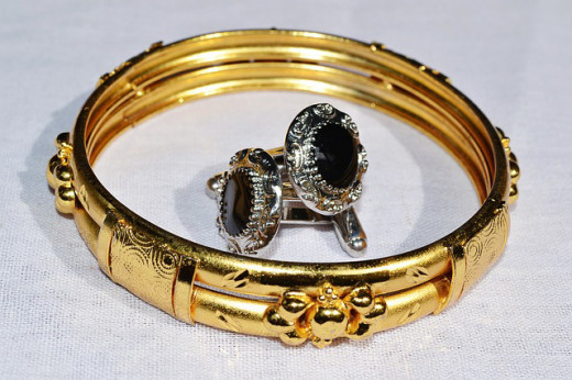 Bracelets, earrings, rings, and other jewelry are found while treasure hunting with a metal detector.