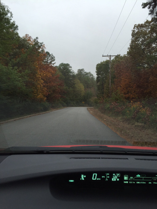 Fall foliage display on a dreary day as seen through my windshield while winding down the hill to Interstate 40.