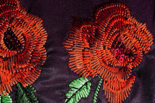 Embroidered needlework of roses.