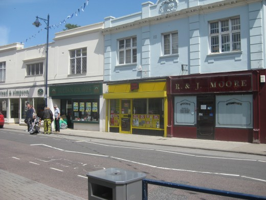 Four shops owned by Wisprole Investments immediately in front of the Post Office building in Gladstone Road. To be demolished maybe, and replaced with a new supermarket?