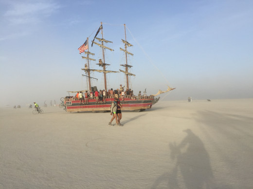 A ship glides through the sea of sand.