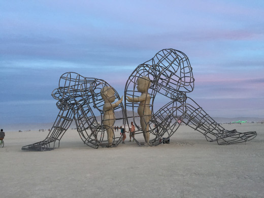 """LOVE is a sculpture by Alexandr Milov. It demonstrates a conflict between a man and a woman as well as the outer and inner expression of human nature."""