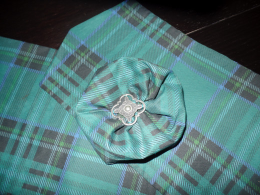 Scottish pin on fabric rose