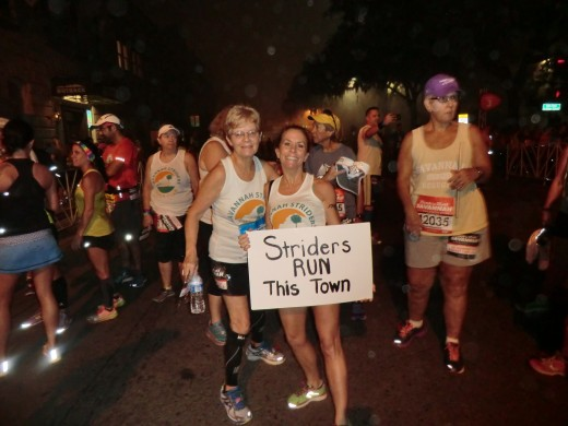 Sherry Feathers and Pam Howe get into the spirit of the race an hour before dawn... no need to wear jackets this year.