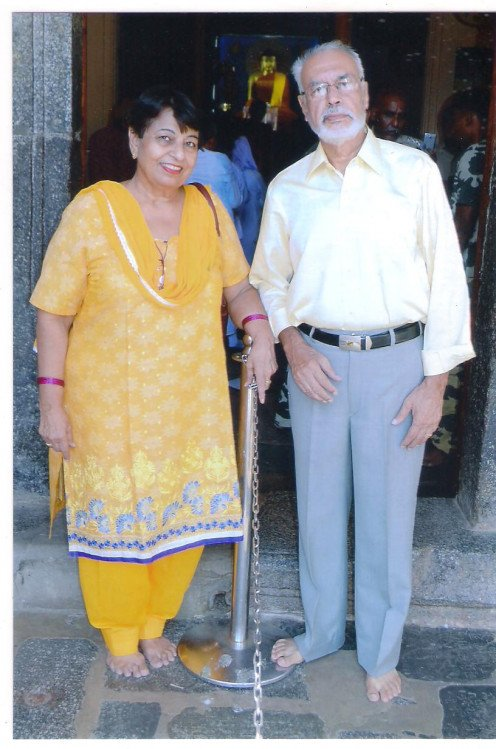 The author with his wife at the entrance of sanctum enshrining the statue of the Buddha