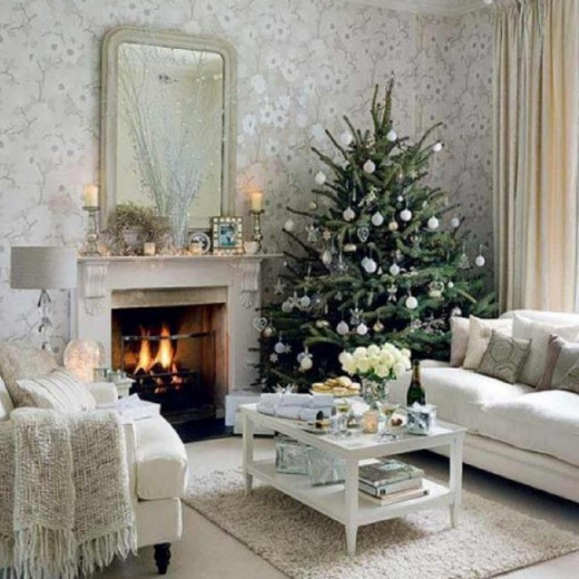 Decorate your room in white, including a natural Christmas tree. Accent with bronze and neutral colored decor.