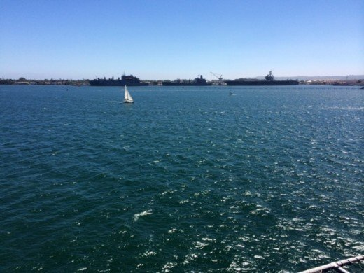 A little sailboat out in the harbor in San Diego.  We were visiting the USS Midway.