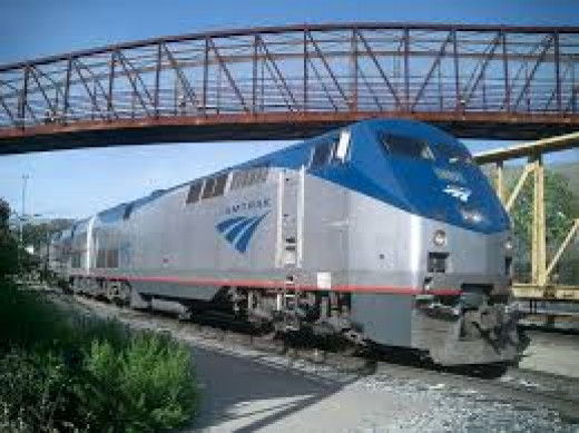 Amtrak's claim that it is condemning a large Washington, D.C. office building to prepare for a $2 billion rail expansion prompted a lawsuit by the building's owner.