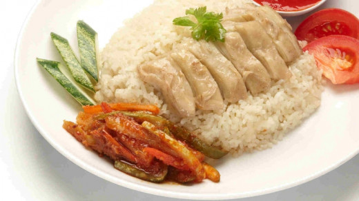 Chicken rice with side dish of prickles (a.k.a achar)