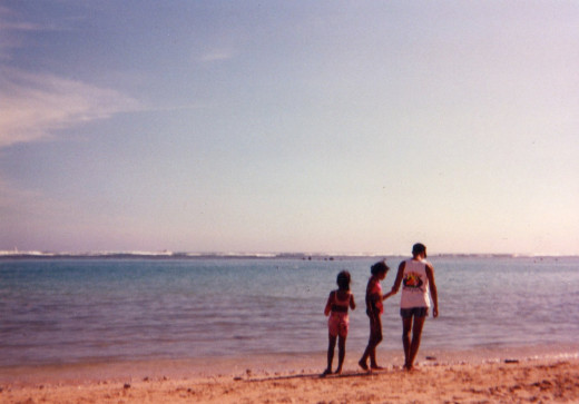 My father, my sister, and I beach combing in Hawai'i
