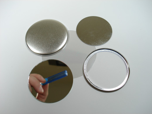 Mylar, Shell, Shim, Collet Ring and Mirror parts are used to create a Mirror Button.