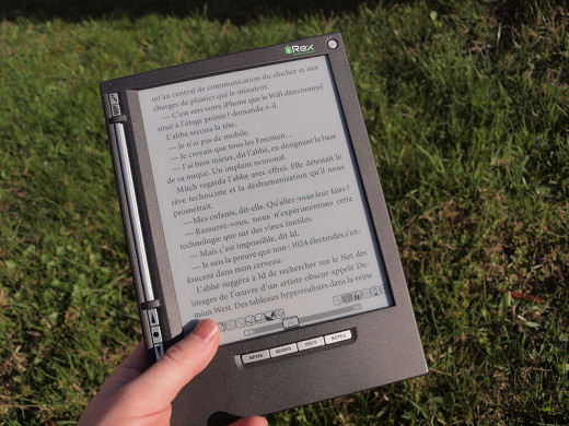 iLiad e-book reader equipped with an e-paper display visible in sunlight