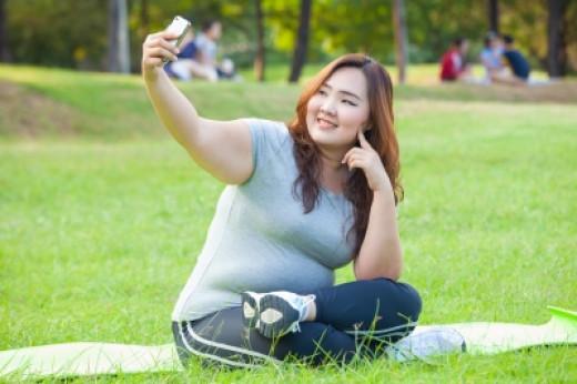 """""""Pretty Female Takes Travel Selfie"""" by Witthaya Phonsawat courtesy of 'freedigitalphotos.net'"""