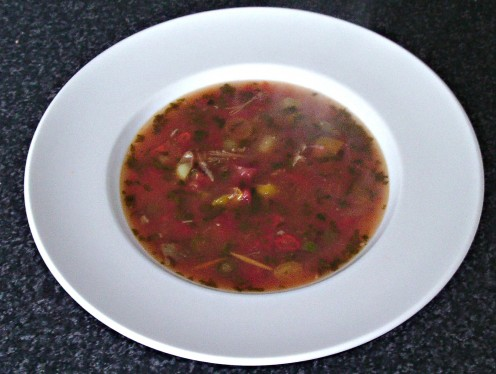 Beef with red, yellow and green tomatoes spicy soup