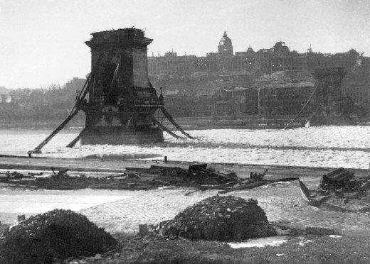 The blown-up liberty bridge and the burnt-down castle in Budapest, during the winter of 1944-45​.
