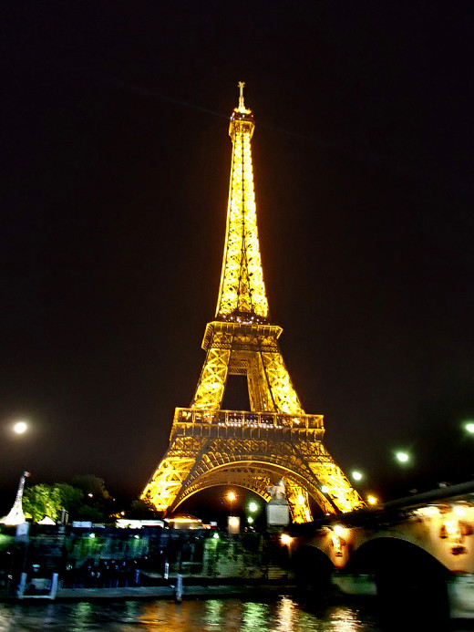 Iconic Eiffel Tower glows brightly at night.