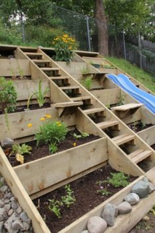 A hill is a natural division in your garden. use it to incorporate different things.