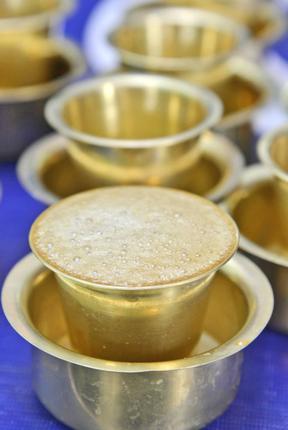 Hot Kumbakonam Degree coffee served in Brass metal tumbler with round bowl