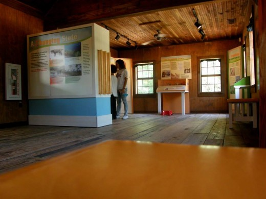 Enjoying the exhibits and history inside the Cabin