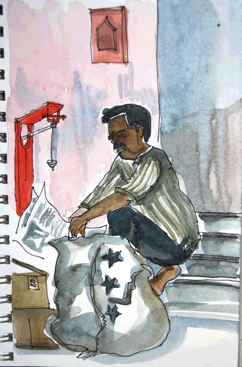 A sketch of a man recycling old papers,bottles etc.