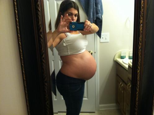 8 months pregnant.